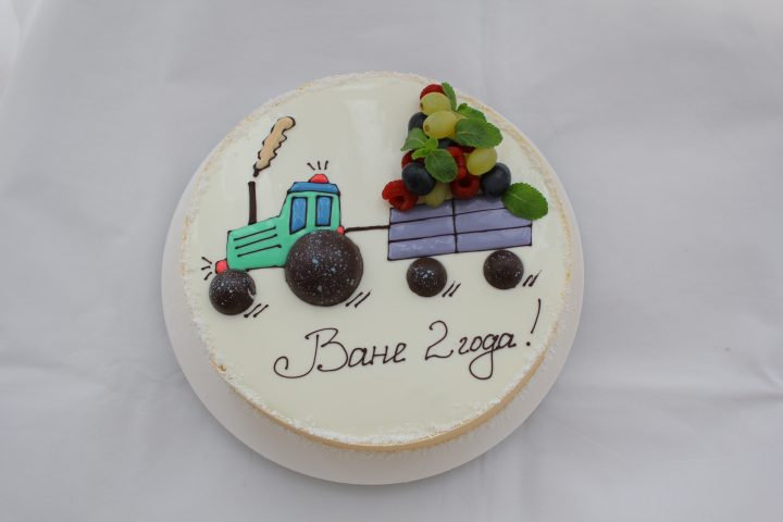 tractor cake with fruits and berries for a kid